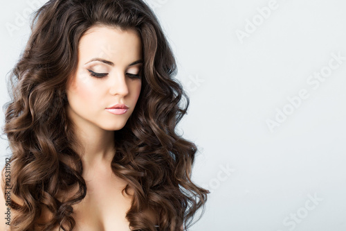 Recess Fitting Hair Salon Woman with wavy hair.
