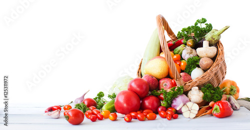 Fresh vegetables and fruits isolated on white background.