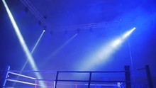 Boxing Ring In Lights Of Projectors Before Fight Night