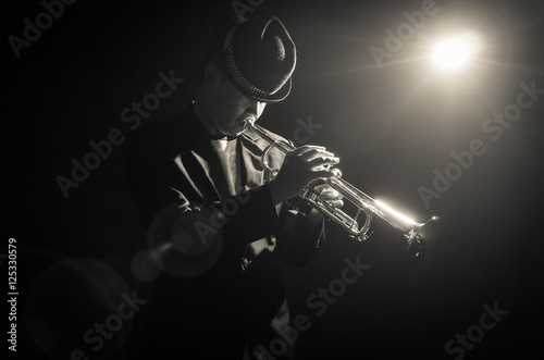 Photo  Musician playing the Trumpet with spot light on the stage