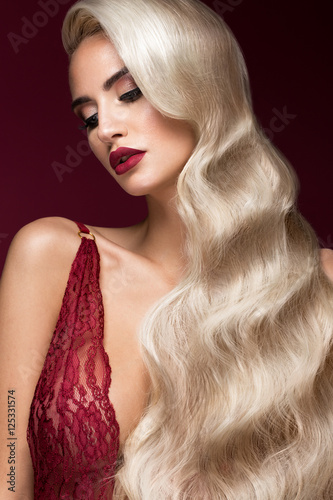 Beautiful blonde in a Hollywood manner with curls, red lips, red lingerie Slika na platnu
