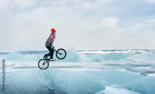 Girl on a bmx on ice. Canvas Print