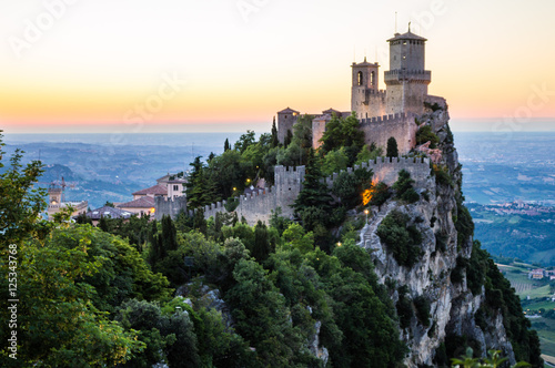Fotografie, Obraz  Rocca della Guaita, the most ancient fortress of San Marino in the sunset time
