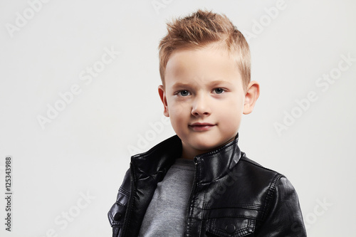 Fashionable child in leather coat.stylish little boy with trendy haircut