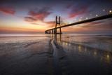 Beautifull sunrise over the Vasco da Gama bridge at Lisbon