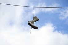 The Old Sneakers Hanging On Wires.