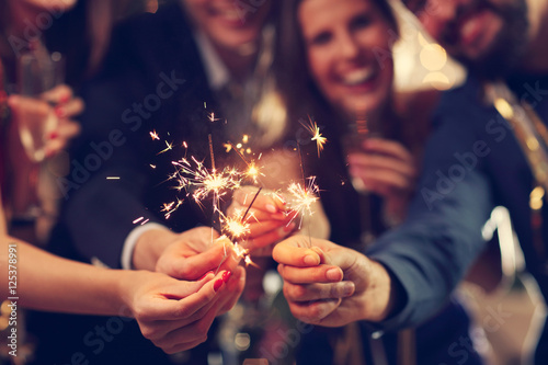 Obraz Group of friends having fun with sparklers - fototapety do salonu