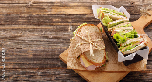 Fotobehang Snack Fresh sandwich with ham cheese and lettuce in bakery mold