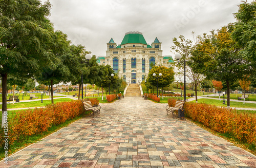 Theater in the park in autumn cloudy day. Astrakhan Wallpaper Mural