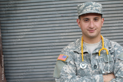 Valokuva  Male American Soldier in Army Camouflage Uniform - Stock image with copy space