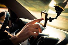 Man  Adjusting  Gps In Car