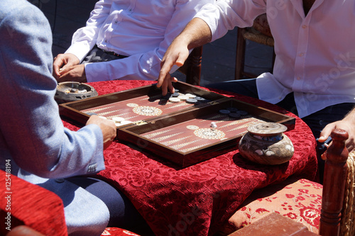 Two men playing a game of backgammon Canvas Print