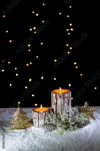 Magic of Christmas - Golden decorations and candles on snow