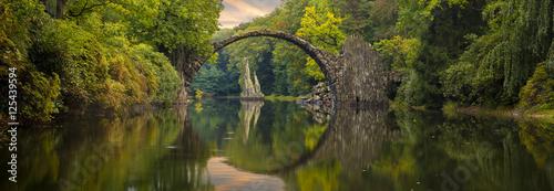 Cadres-photo bureau Rivière de la forêt Autumn over Devil's bridge in the park Kromlau, Germany