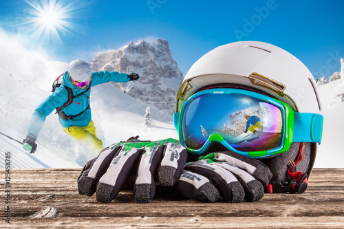 Acrylic Prints Winter sports Ski goggles with reflection of winter mountains.