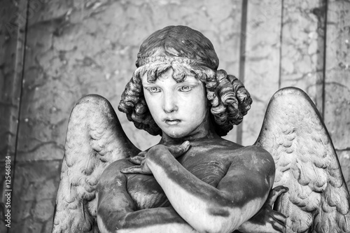 Carta da parati Portrait of loving angel on marble, monumental cemetery of Genoa, Italy, one of the most important monumental cemeteries in Europe
