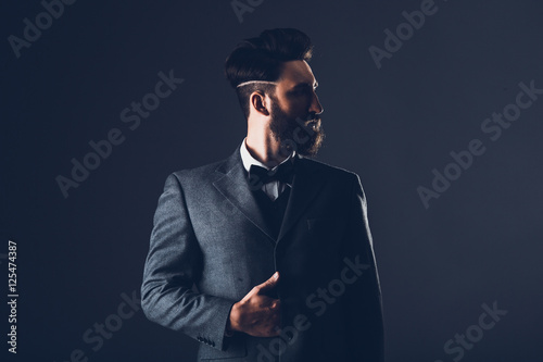 Fotografie, Obraz  Young handsome bearded caucasian man posing indoors
