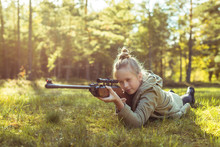 Girl Shooting From The Air Rifle In The Forest