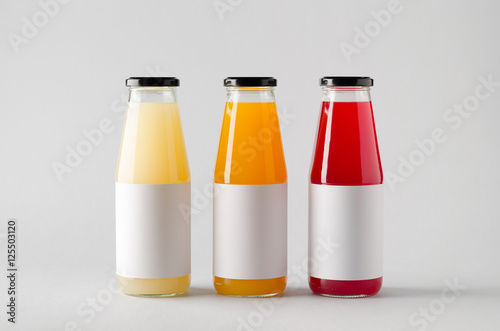 Garden Poster Juice Juice Bottle Mock-Up - Three Bottles. Horizontal Label