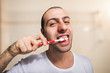 Portrait of a man cleaning his teeth