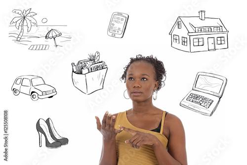Fotografía  jeune femme noire comptant son budget avec dessins