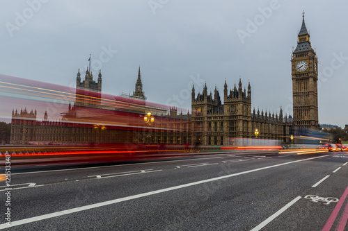 Fotobehang Londen rode bus Red bus in motion and Big Ben, the Palace of Westminster. London, the UK.