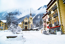 Church In Chamonix, France, French Alps In Winter, Street View And Snow Mountains