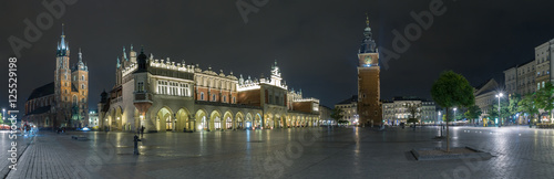 Long exposure wide panoramic view of the market square in the center of the old town of Krakow, Poland.