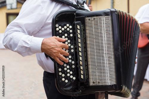 Hand playing accordion closeup Tapéta, Fotótapéta