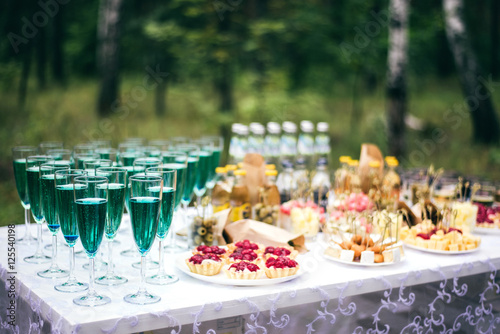 Wedding buffet outdoors with champagne, tartlets, canapés and snacks