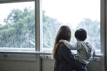 Mother Is Looking Out Of The Window To Hug His Son