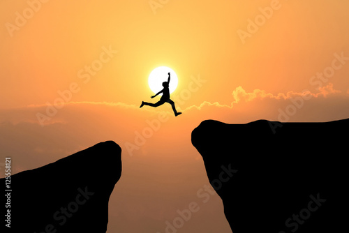 Man jump through the gap between hill Canvas Print