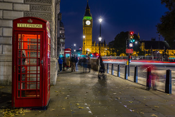 Famous English red telephone boxes with Big Ben in London at nig