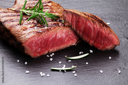 Papiers peints Steakhouse Grilled beef steak with rosemary, salt and pepper