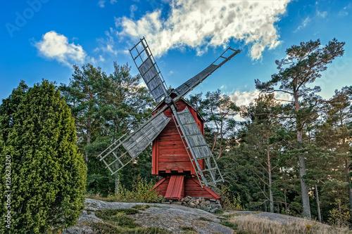Tuinposter Molens Red ochre colour wooden windmill