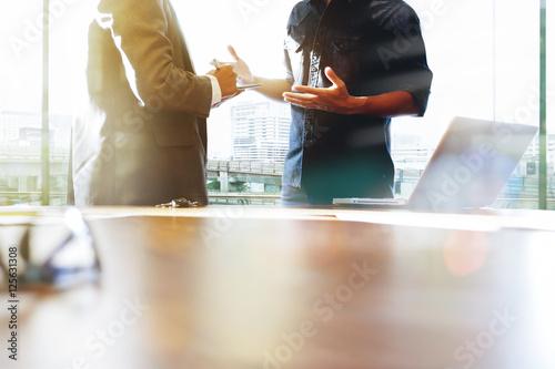 Obraz na plátně  Team meeting to discuss and analyze business informaion.
