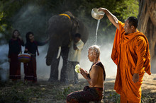 Monk Giving Water Blessing To Another Monk