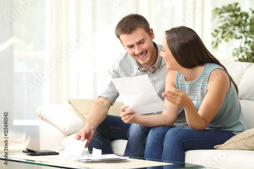 Fotografia, Obraz  Couple reading mail at home