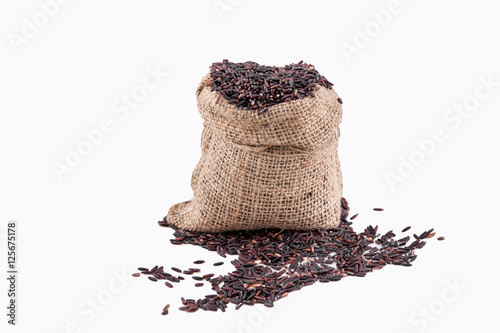 Photo Stands Coffee bar Riceberry rice in sacks on a white background