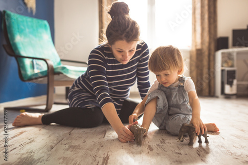 young pregnant mother and son playing on floor, lifestyle,