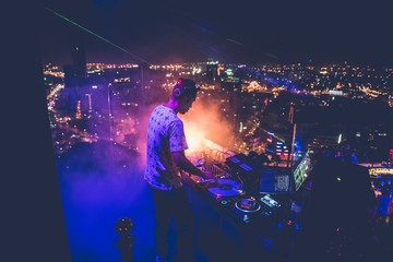 Fototapeta na wymiar DJ - Party on top of building with music entertainment