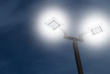 LED Outdoor Car Park Flood Light Working On Night, Saving Energy.