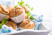 Delicious Homemade Coconut Cinnamon Muffins And Mint Leafs On Old White Tray. Healthy Food Concept With Copy Space.