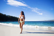 young woman walking in the beach
