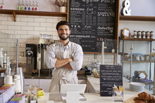 Business Owner At The Counter Of Coffee Shop, Arms Crossed