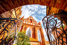 View From The Gates On The Beautiful Francis Of Assisi Gothic Church In The Old Town Of Vilnius City, Lithuania.