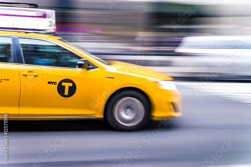 Foto op Plexiglas New York TAXI NYC taxi in motion. Blurred, long exposure images.