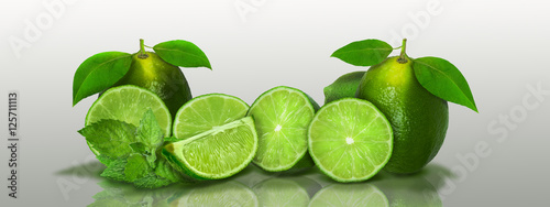 Sliced and whole limes in a panoramic