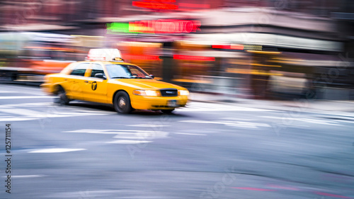Photo sur Aluminium New York TAXI NYC taxi in motion. Blurred, long exposure images.