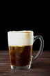 Irish coffee on the dark wooden background